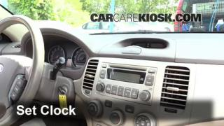 How to Set the Clock on a Kia Optima (2006-2010)